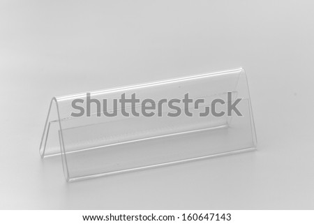 Acrylic card holder for events. Isolated transparent object with white background. - stock photo