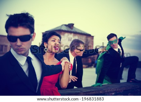 Action Scene of Business People : A Hero in a Corporate Attire Trying to Save the Woman  - stock photo