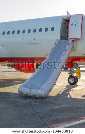 activated emergency slide on the plane - stock photo