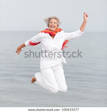 Active and happy senior woman - stock photo