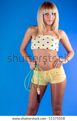 Active blonde on a blue background - stock photo