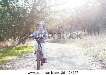 active boy biking in the park - stock photo