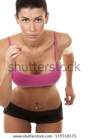active brunette in sport wear running on white isolated background - stock photo