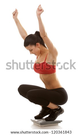 active brunette using scale on white isolated background - stock photo