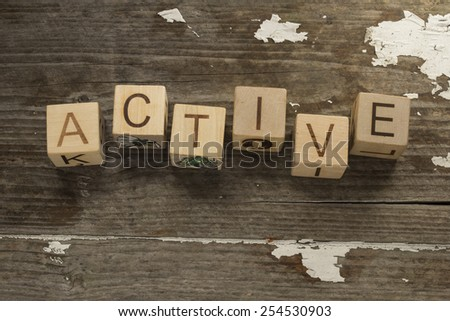 active Concept text on a wooden background - stock photo