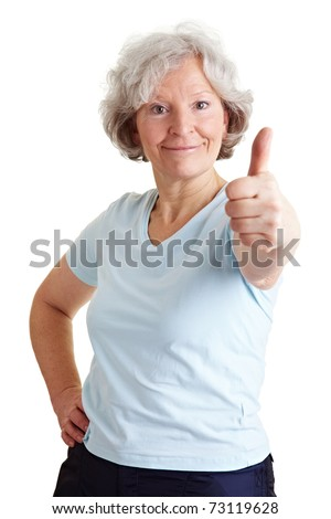 Active elderly woman holding her thumb up - stock photo