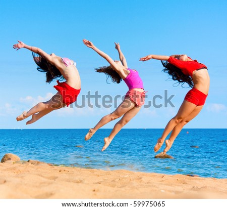 Active girls on a beach - stock photo