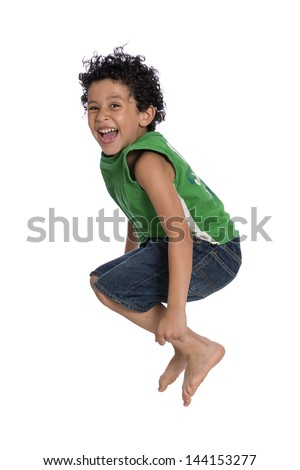 Active Joyful Boy Jumping with Joy over White Background - stock photo