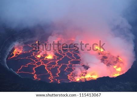 Active lava lake in pit crater, Nyiragongo Volcano, Democratic Republic Congo - stock photo