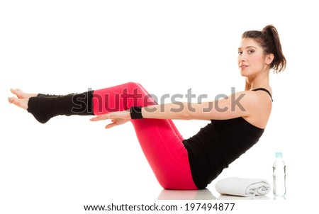 Active lifestyle. Sporty flexible girl doing stretching pilates exercise isolated on white. Fitness woman in yoga position. - stock photo