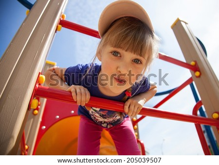 Active little girl on playground - stock photo