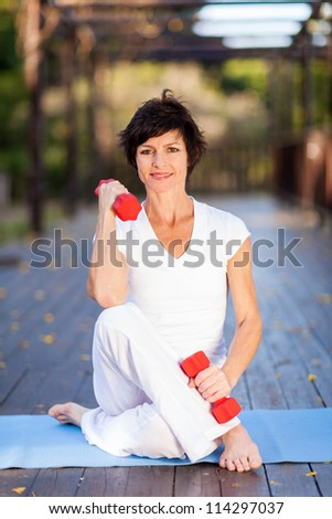 active middle aged woman exercise with dumbbells - stock photo