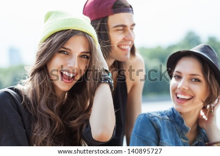 Active people. Closeup of group of happy young women and man. Outdoors, lifestyle - stock photo