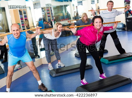 Active people do aerobics and crossfit in a sport club - stock photo