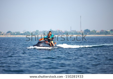 active people riding on watercraft. summer fun - stock photo