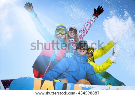 Active people with snowboards outdoors - stock photo