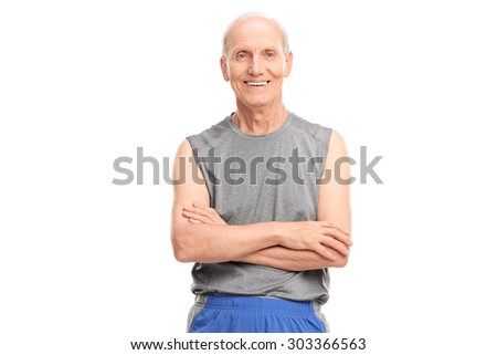 Active senior in sportswear posing with his arms crossed and looking at the camera isolated on white background - stock photo