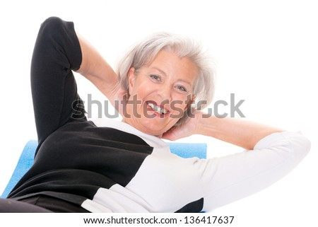 Active senior woman at workout in front of white background - stock photo