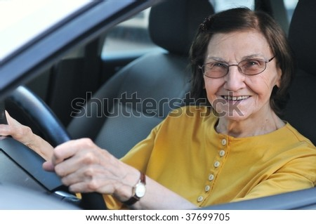 Active senior woman - smiling retired lady driving car, detail - stock photo
