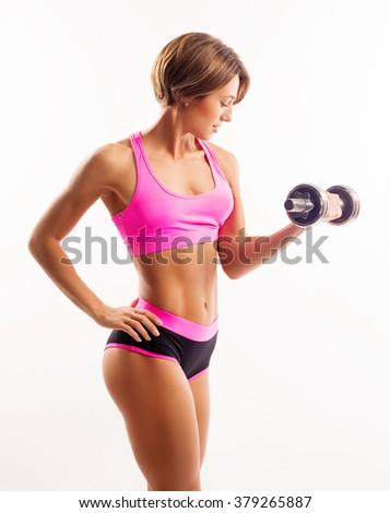Active sportive athletic woman with dumbbells pumping up muscles biceps concept fitness sport training lifestyle  - stock photo