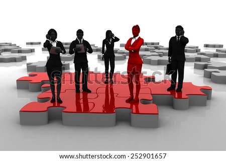 Active team on Jigsaw puzzle. A successful active team working like pieces of a jigsaw puzzle thanks to their leader. - stock photo