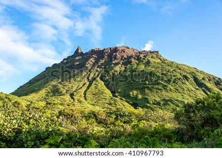 """Active volcano """"La Soufriere"""" with sulfuric smoke, Guadeloupe - stock photo"""