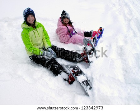 Active Winter Snowshoeing in White Snow with Snowshoes - stock photo