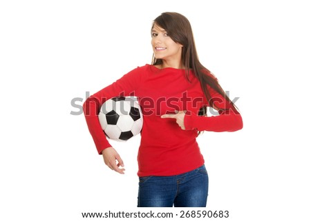 Active woman pointing on a soccer ball. - stock photo