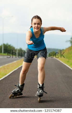 Active young people - girl rollerblading - stock photo