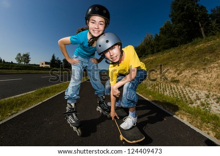 Active young people - rollerblading, skateboarding - stock photo