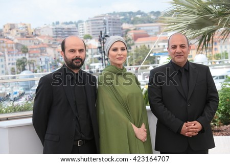 Actor Ali Mosaffa, actress Sahar Dolatshahi and director Behnam Behzadi attend the 'Inversion' Photocall during the 69th annual Cannes Film Festival at the Palais on May 18, 2016 in Cannes, France. - stock photo