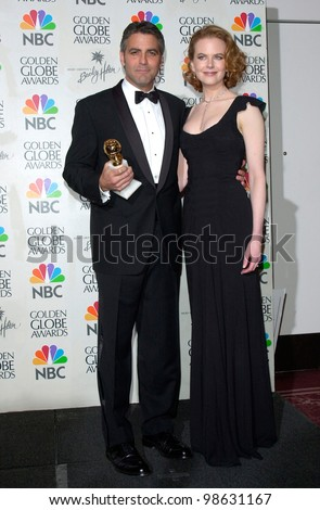 Actor GEORGE CLOONEY & actress NICOLE KIDMAN at the 2001 Golden Globe Awards at the Beverly Hilton Hotel. 21JAN2001.   Paul Smith/Featureflash - stock photo
