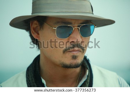 Actor Johnny Depp attends the 'Pirates of the Caribbean: On Stranger Tides' Photocall during the 64th Annual Cannes Film Festival at Palais des Festivals on May 14, 2011 in Cannes, France. - stock photo