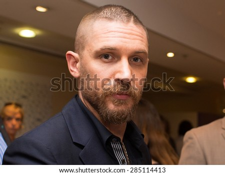 Actor Tom Hardy with fans,  'Mad Max : Fury Road' Photocall during the 68th annual Cannes Film Festival on May 14, 2015 in Cannes, France. - stock photo