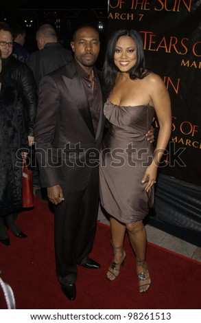 Actress LELA ROCHON & director husband ANTOINE FUQUA at the Los Angeles premiere of his new movie Tears of the Sun. 03MAR2003.   Paul Smith / Featureflash - stock photo