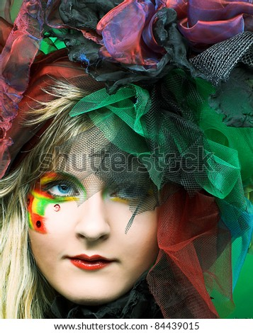 Actress. Young woman in creative image with fan. - stock photo