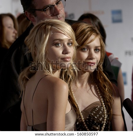 Actresses Mary Kate and Ashley Olsen attend the premiere of NEW YORK MINUTE at the Tribeca Performing Arts Center on May 4, 2004 during the Tribeca Film Festival in New York - stock photo