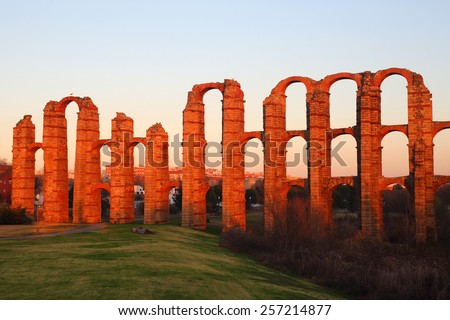 Acueducto De Los Milagros, Roman aqueduct. Lit by the late afternoon sunlight (sunset) Merida, Spain. UNESCO World Heritage site. - stock photo