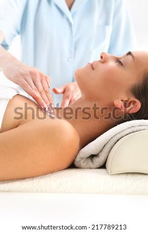 Acupressure. Beauty salon, woman at face massage. - stock photo
