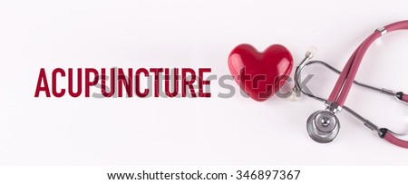ACUPUNCTURE concept with stethoscope and heart shape - stock photo