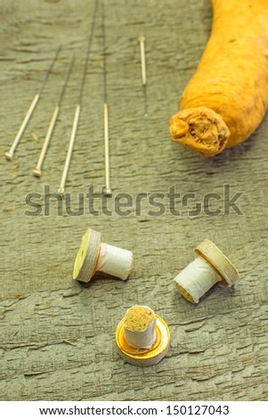 acupuncture needles, moxibustion cones and ginseng root - stock photo