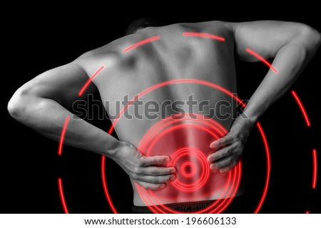 Acute pain in a male lower back, monochrome  image, pain area of red color - stock photo