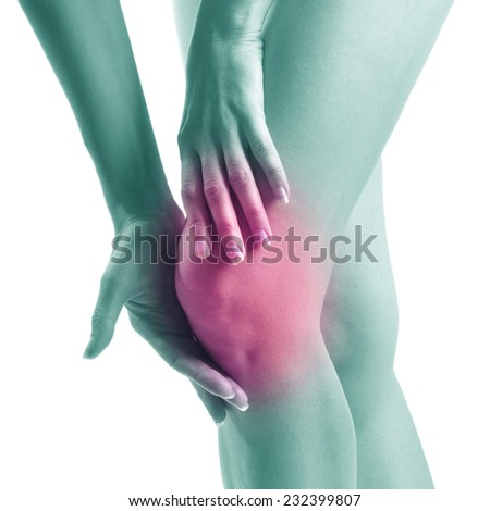Acute pain in a woman knee - stock photo