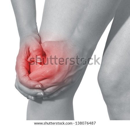 Acute pain in a woman knee. Isolation on a white background - stock photo