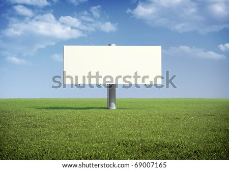 Ad billboard standing in a field of grass - stock photo