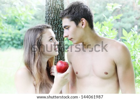 Adam and Eve with a red apple - stock photo