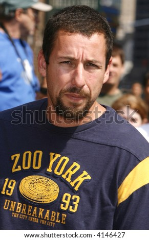 Adam Sandler stops by The Late Show With David Letterman at The Ed Sullivan Theatre on July 17, 2007 in New York City. - stock photo