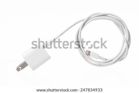Adapter Charger with usb cable on white - stock photo