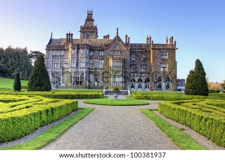 Adare Manor is a 19th century manor house located on the banks of the River Maigue in the village of Adare, Co. Limerick - Ireland. - stock photo