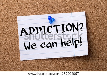 ADDICTION? We can help! - teared note paper pinned on bulletin board - horizontal image - stock photo